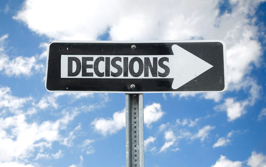 Decisions direction sign with sky background